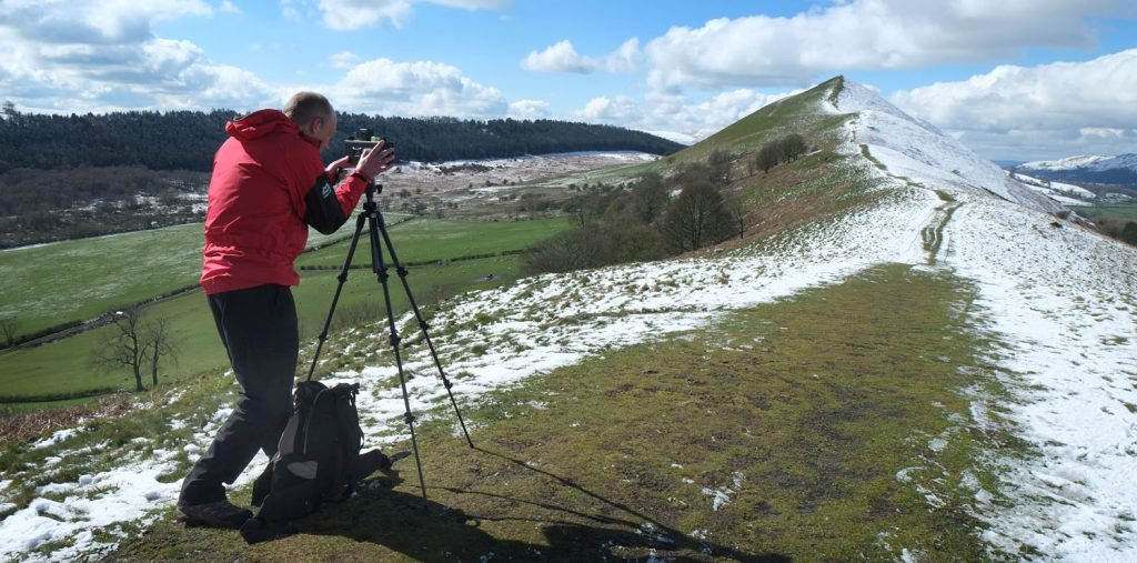 Landscape photography - taking pictures on a snowy hillside in Shropshire during a 121 photography course