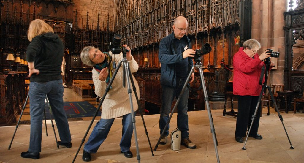 students on a photography workshop in a cathedral
