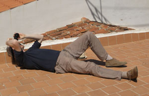 a male photographer lies on his back to take a picture