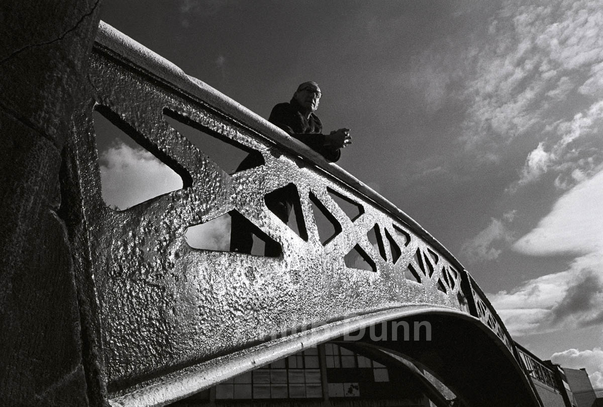 Strong back light brings out the texture of an iron bridge, Birmingham canal