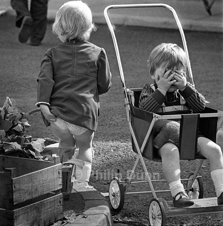 Street photograph of children in market, Ludlow, Shropshire