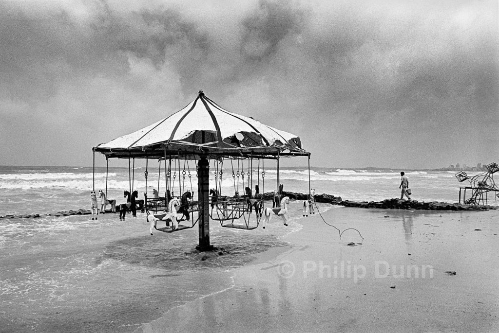 beach fairground washed by the tide at Juhu, Bombay, India