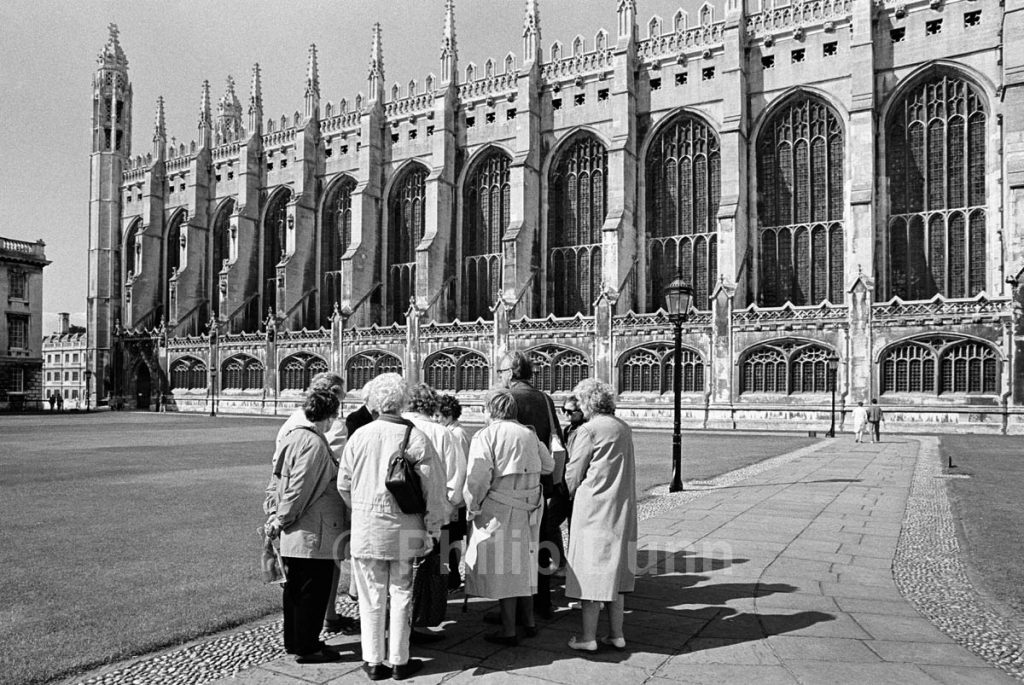 black and white photograph of tourist group outside Christ Church Cambridge