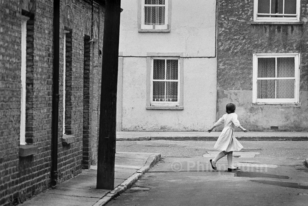 Street Photography Ireland - a girl twirls in her new dress