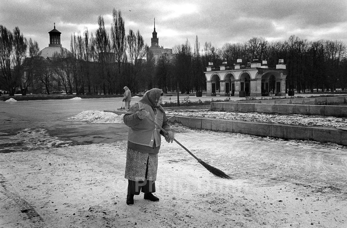 Female street sweeper in Warsaw, Poland in winter