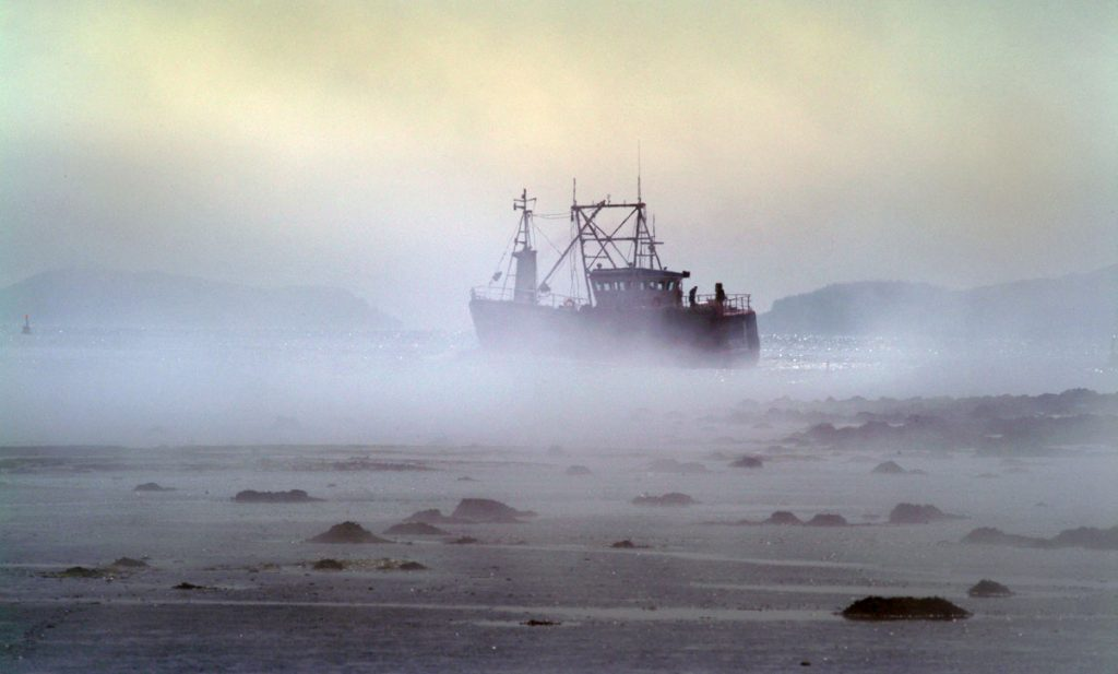 photographing in fog. fishing boat
