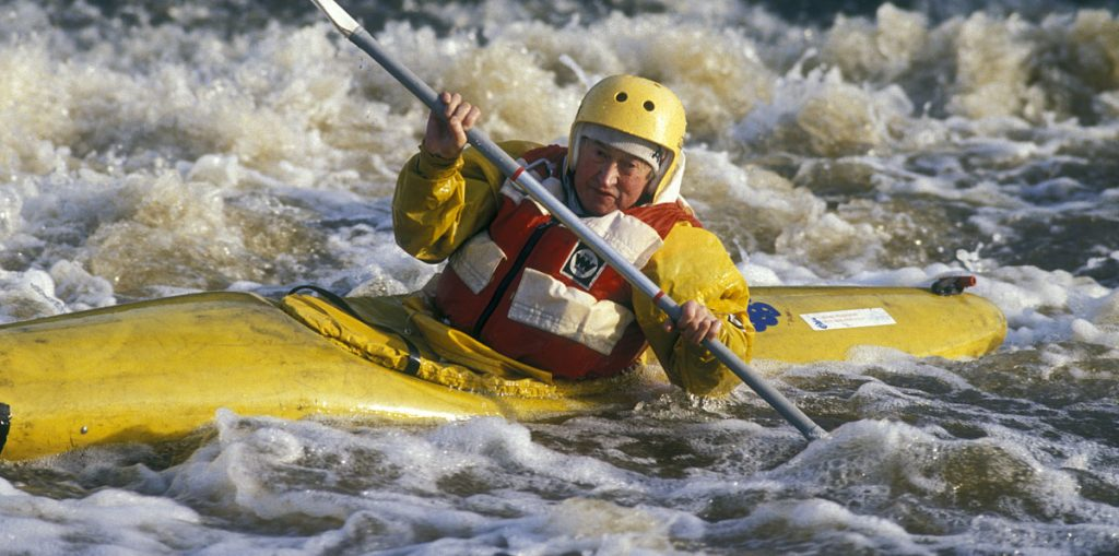 capturing the action - canoeist in weir