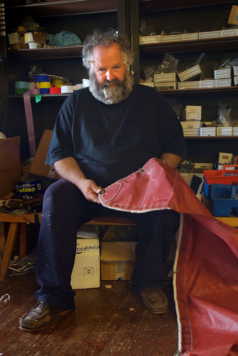 Photographing craftsmen - Sailmaker portrait with red sail