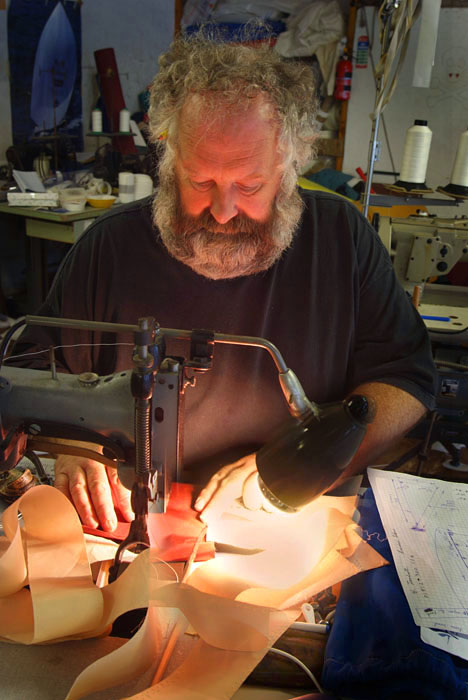 Sailmaker working at sewing machine